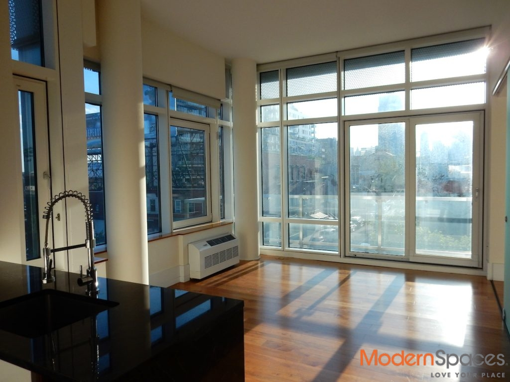 Super sunny 2 bedrooms, 2 baths with large balcony and city views, 1 block from 7 train