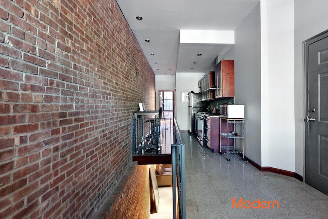 LIC 2 bed duplex; hard wood floors; brick walls