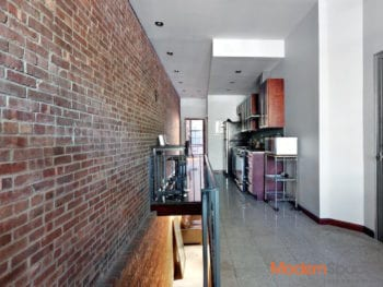LIC 2 bed duplex; hard wood floors; brick walls