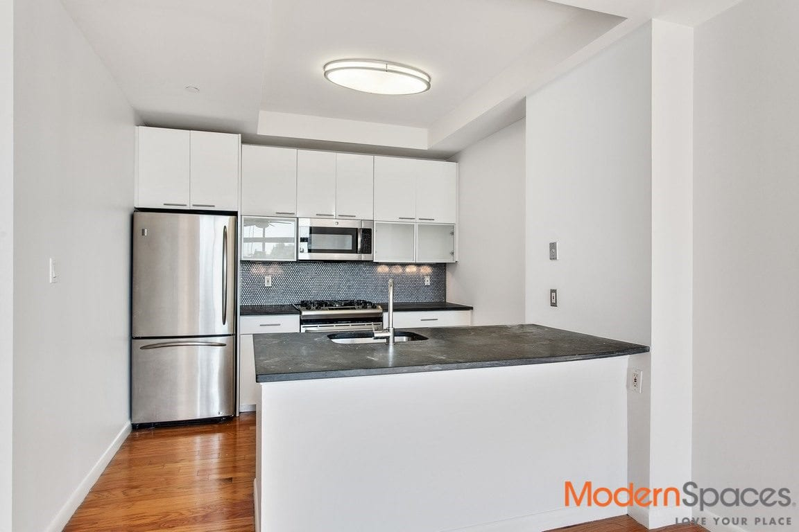 Split 2 Bedrooms/2 Baths w/ Assigned Parking & Private Terrace | 1 block from Waterfront